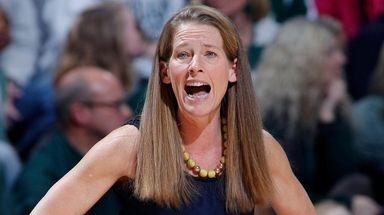 Michigan coach Kim Barnes Arico gives instructions against
