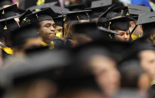 Graduates listen during the commencement at Farmingdale State