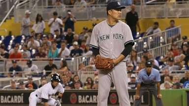 Masahiro Tanaka #19 of the Yankees sets to