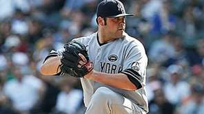 Yankees pitcher Joba Chamberlain pitches against the Red