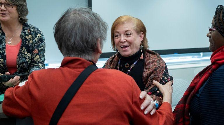 Holly Shaw, center, an associate professor at Adelphi