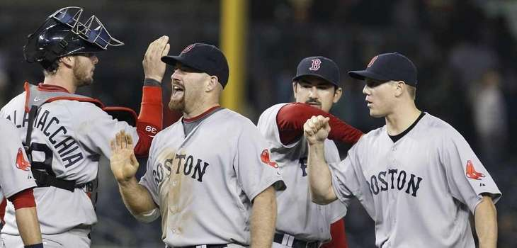 Teammates, including catcher Jarrod Saltalamacchia congratulate Boston Red