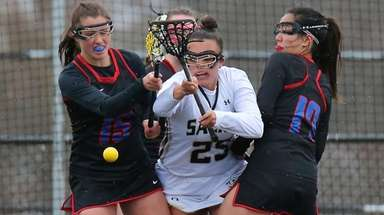 Sachem North's Danielle Scarfogliero battles with three Middle