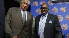 Former New York Knick legends Willis Reed (L)