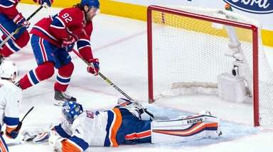 The Canadiens' Jonathan Drouin scores past Islanders goaltender
