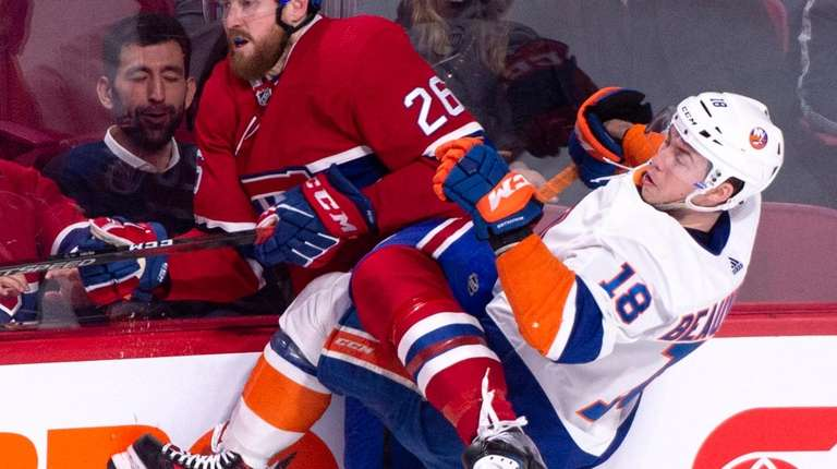 Montreal Canadiens' Jeff Petry gets tangled up with