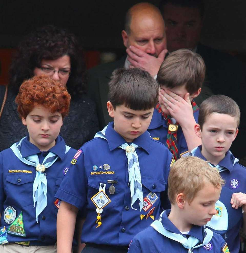 Cub scouts leave Our Lady of Victory Roman