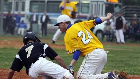 St. Anthony's Matt Zsevic gets tagged out at