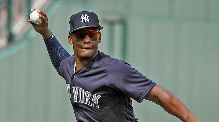 Yankees' Miguel Andujar makes a play against the