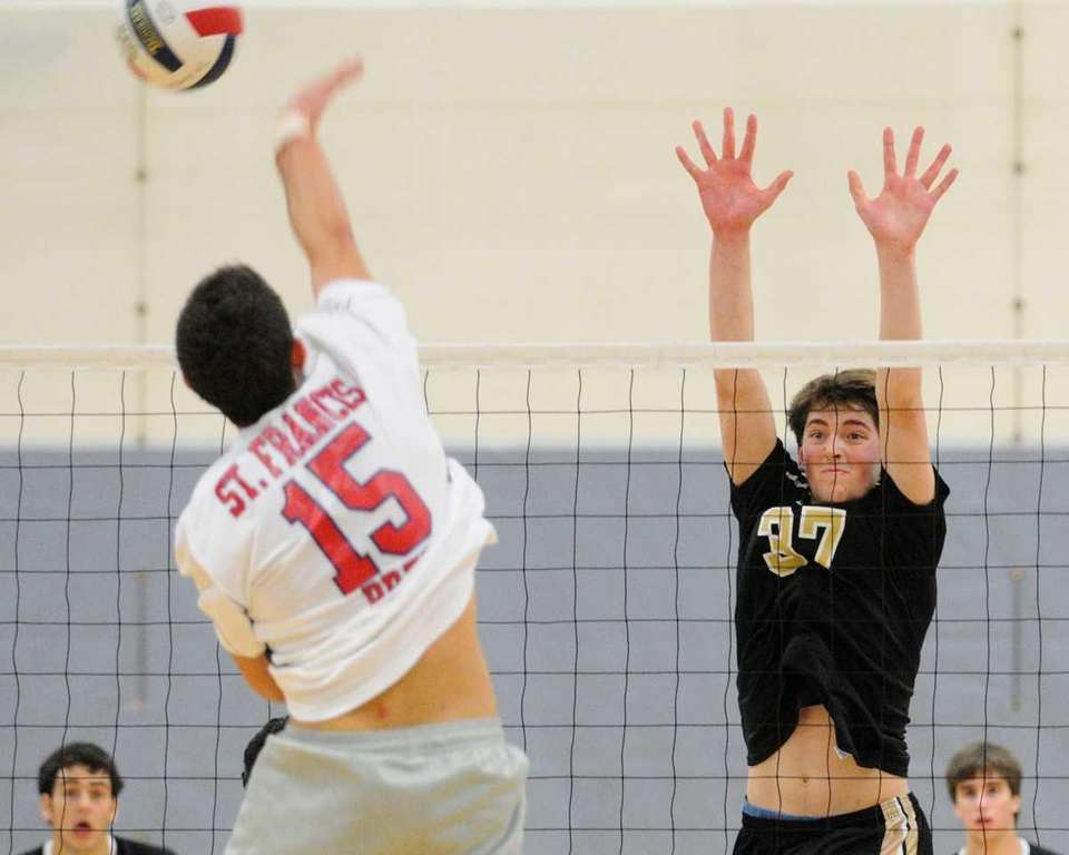 St. Anthony's Tanner Medina, right, defends at the