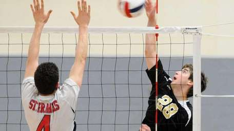 St. Anthony's Andrew Melon, right, attempts to spike