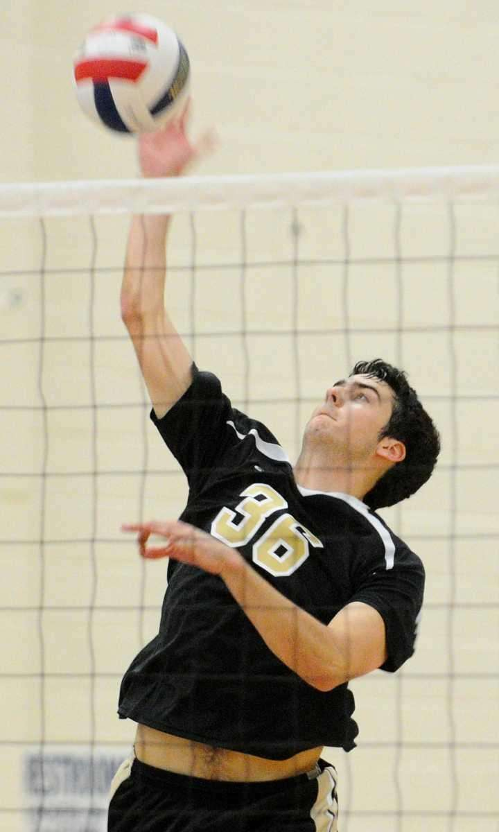 St. Anthony's Scott Van Duyne attempts a spike