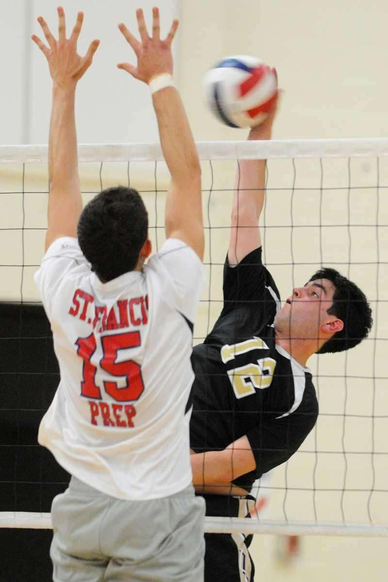 St. Anthony's Joseph Groneman, right, attempts to spike