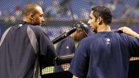 The Yankees' Derek Jeter, left, and Jorge Posada