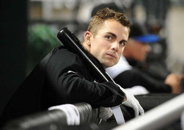 Injured Mets third baseman David Wright sits in