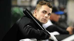 Injured Mets third baseman David Wright sits in