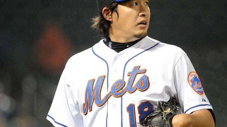 Mets relief pitcher Ryota Igarashi walks back to