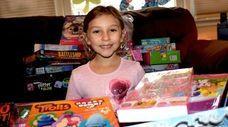 Emma Vulpi, 7, of East Meadow, sits among