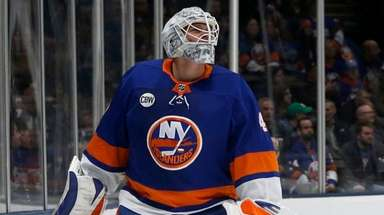 Robin Lehner of theIslanders looks on after surrendering