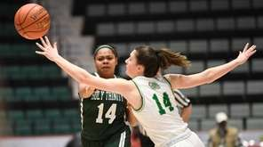 Holy Trinity's Katie Sinclair ,left, passes the ball