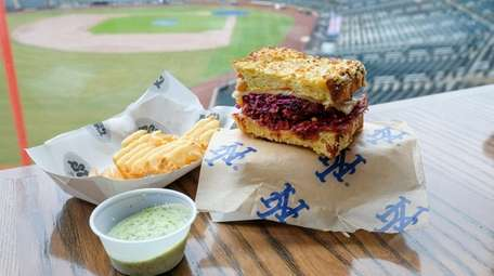 Stuf'd Reuben is topped with purple slaw.