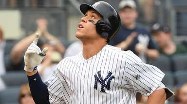 Yankees rightfielder Aaron Judge reacts as he scores