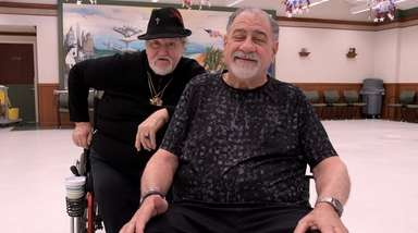 Robert Nieves, 69, (at left) of Smithtown, and