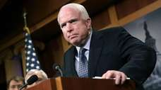 Sen. John McCain (R-Ariz.) speaks during a news