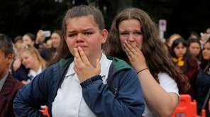 Students react as they gather for a vigil