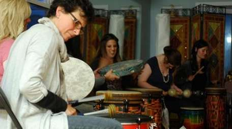 Donna Nesteruk leads a women's drumming circle at