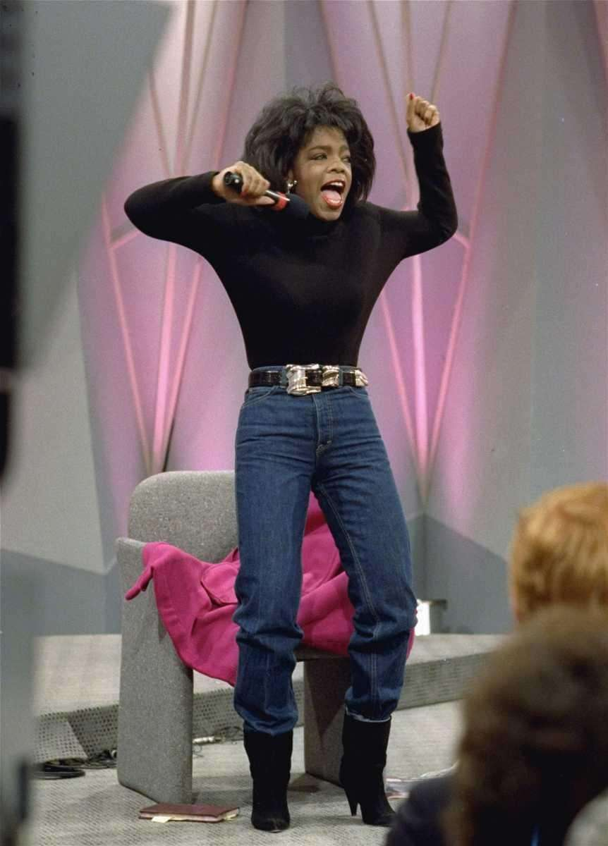 Television talk-show host Oprah Winfrey shows off her