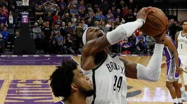 Nets forward Rondae Hollis-Jefferson, right, goes up for