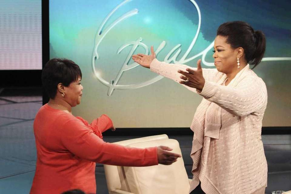 Talk-show host Oprah Winfrey greets her half-sister Patricia