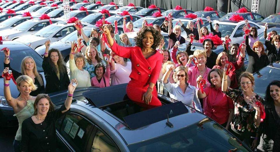 Talk show host Oprah Winfrey sits atop a