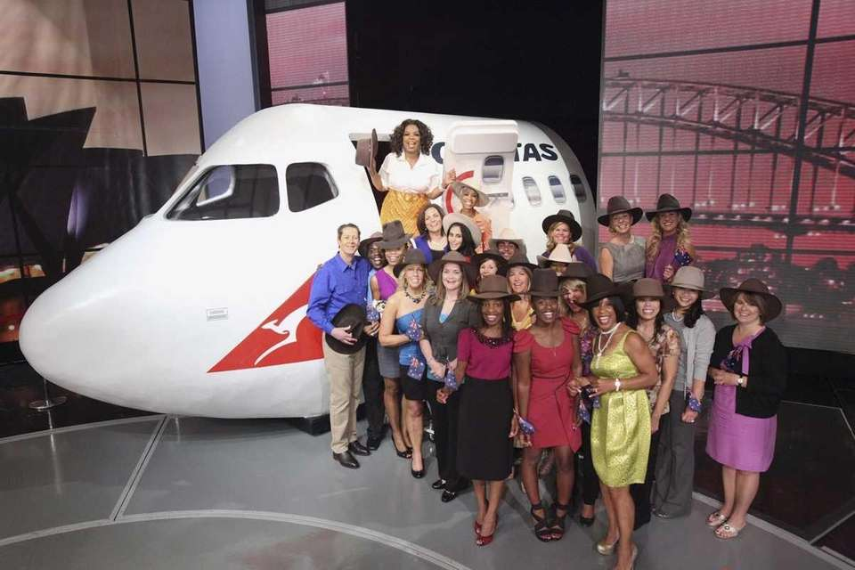 Oprah Winfrey stands with audience members on Sept.