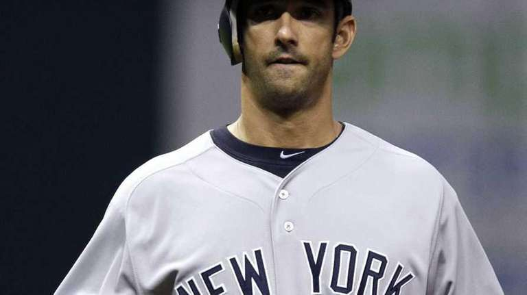 New York Yankees' Jorge Posada walks back to