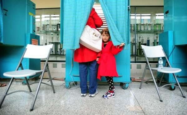 Four-year-old Giavanna Moscardino peeks out from behind the