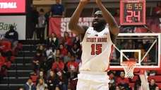 Stony Brook guard Akwasi Yeboah shoots for a