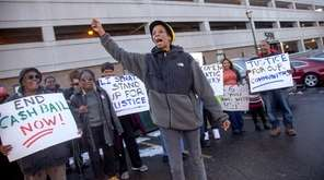 Demonstrators rally for criminal justice reform outside the