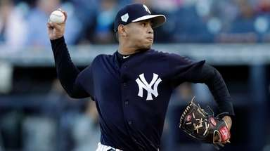 The Yankees' Jonathan Loaisiga pitches to the Phillies