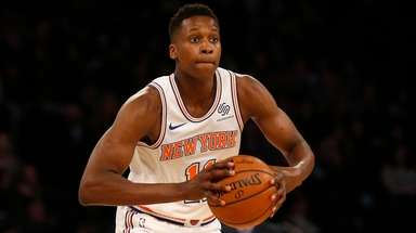 Frank Ntilikina of the Knicks controls the ball