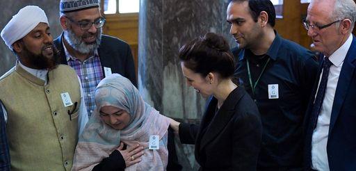 New Zealand Prime Minister Jacinda Ardern (C) meets