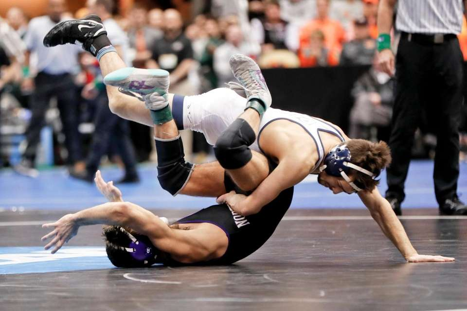 Virginia's Jack Mueller, top, takes down Northwestern's Sebastien