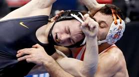 Iowa's Spencer Lee, left, grapples with Oklahoma State's
