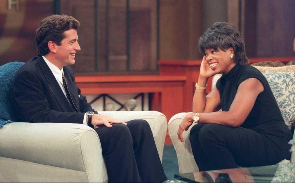 John F. Kennedy Jr. talks to Oprah Winfrey
