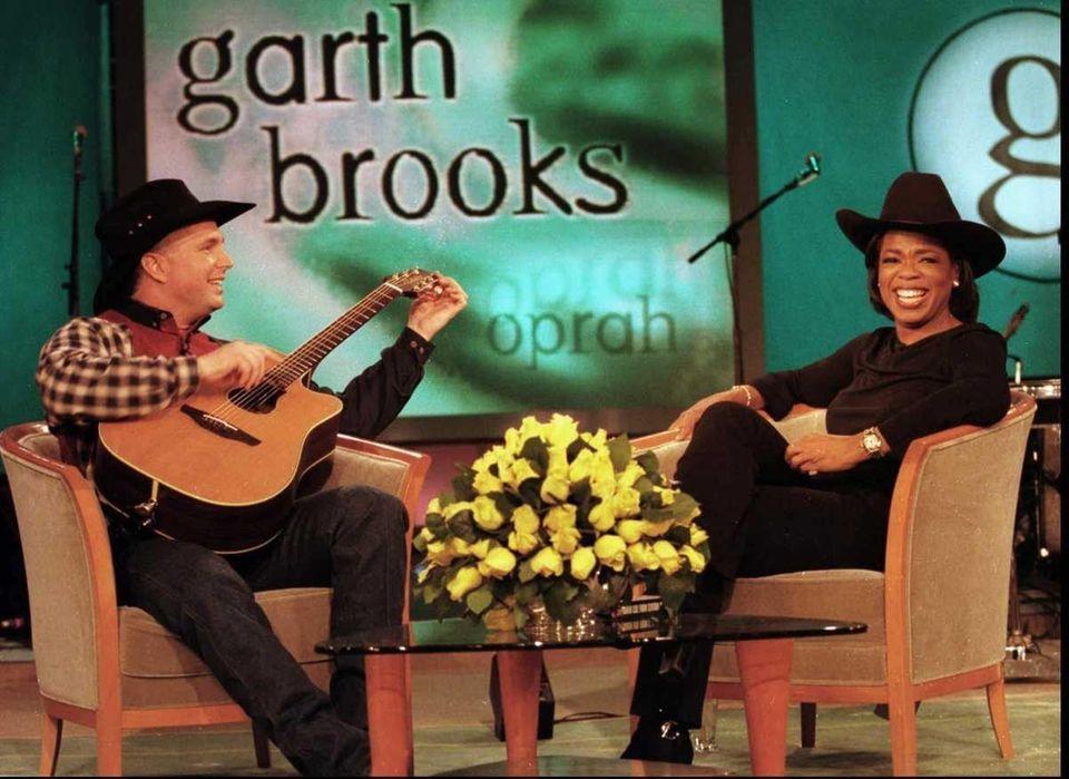 Oprah Winfrey breaks into a smile as Garth
