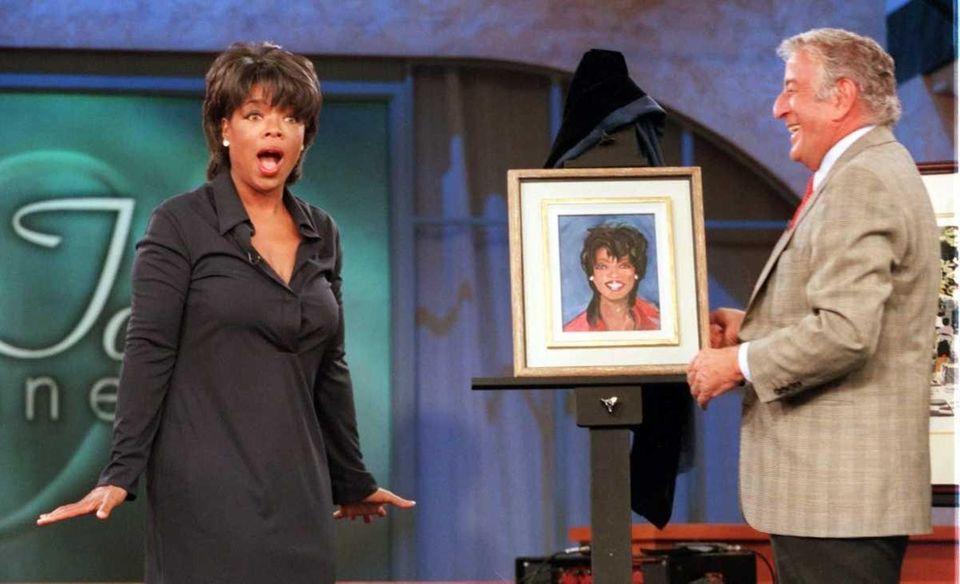 Oprah Winfrey is surprised by Tony Bennett, who