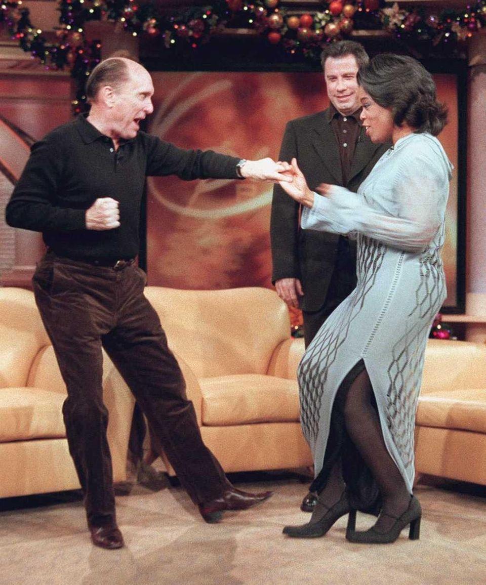 Actor Robert Duvall, left, dances a tango with