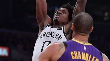 Nets forward Ed Davis, left, shoots as Lakers