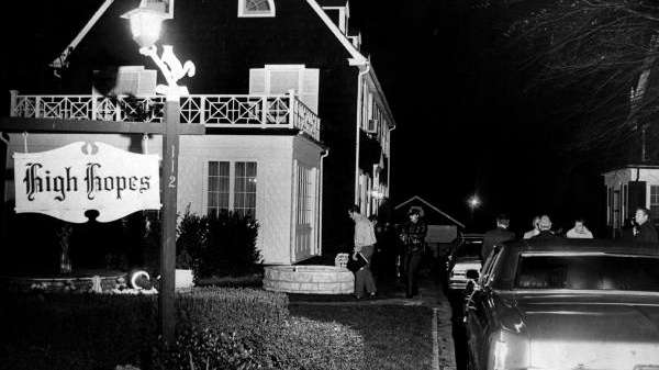 Police investigate the Amityville house on Ocean Avenue